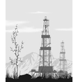 Oil rigs over mountain range vector