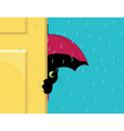 Cat under an umbrella vector