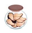 A jar of preserved black truffle mushrooms vector