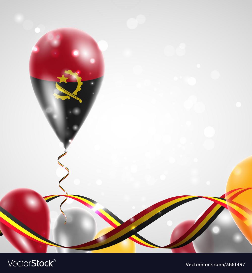Flag of angola on balloon vector | Price: 1 Credit (USD $1)