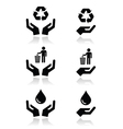 Hands with green ecology symbols icons set vector