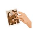 Hand holding family photo sepia isolated vector