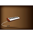 A musical melodica on dark brown background vector