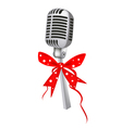 A beautiful vintage microphone with red ribbon vector