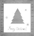 Paper christmas tree on wood background vector