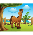 Happy brown horse inside a fence vector
