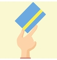 Flat design style icon hand holds credit card vector