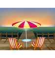 A wooden bridge with an umbrella and chairs vector