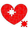 Jigsaw puzzle in the red heart vector