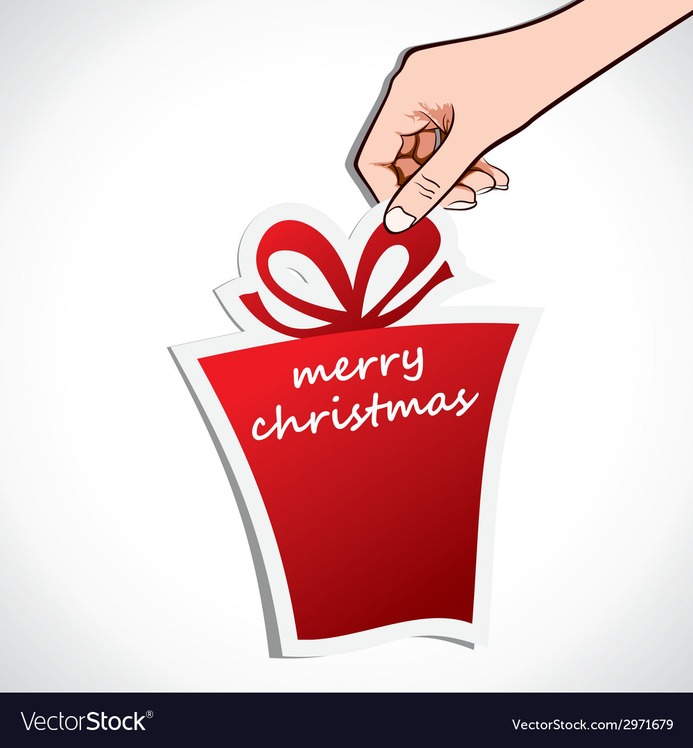 Merry christmas gift in hand vector | Price: 1 Credit (USD $1)