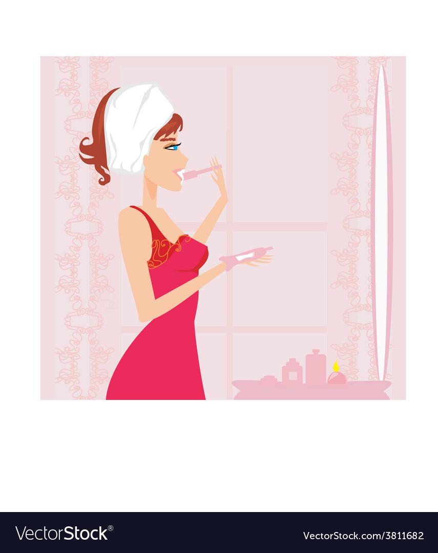 Woman brushing her teeth in the bathroom vector | Price: 1 Credit (USD $1)