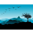 Tree with mountains vector