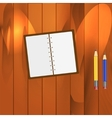 Notepad and pencils on the table vector