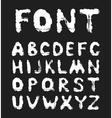 Grunge white alphabet on a black background vector