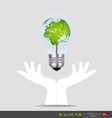 Hand holding an electric light bulb with tree vector