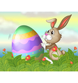 A rabbit and a large egg in the garden vector