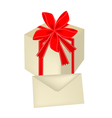 A gift box with red ribbon and card vector
