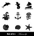Black icons of marine life vector