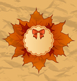 Vintage greeting card with autumn maple leaves vector