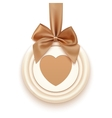 Badge with heart golden ribbon and a bow vector