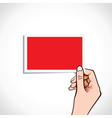 Blank red card in hand vector