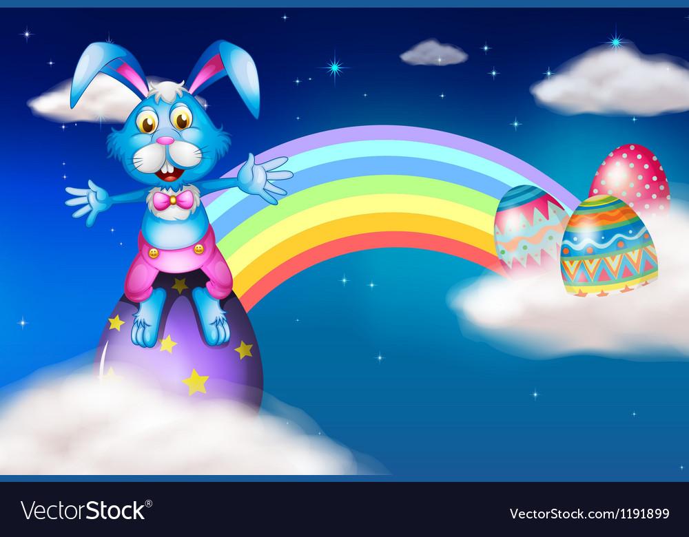 An easter bunny and eggs near the rainbow vector | Price: 1 Credit (USD $1)