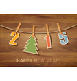 2015 with a christmas tree on wooden background vector