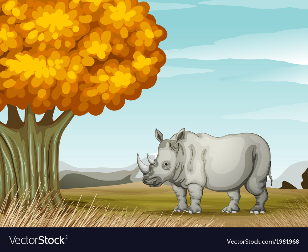 A rhinoceros near the tree vector | Price: 1 Credit (USD $1)