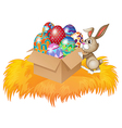 A bunny pushing a box full of easter eggs vector