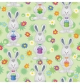 Seamless pattern easter bunnies with gift boxes vector