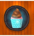 Cupcake with chocolate cream vector