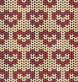 Seamless knitted pattern with red hearts vector