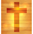 Lighted holy cross over wooden board background vector