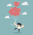Holding red heart balloons vector