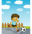 Young boy playing soccer vector