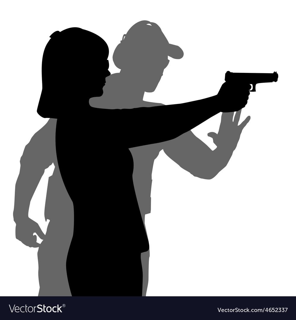 Instructor assisting woman aiming hand gun at vector | Price: 1 Credit (USD $1)