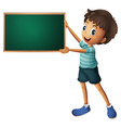A boy holding an empty blackboard vector