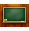 Blackboard with green apple on wooden background vector