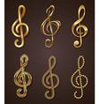Set of golden decorative treble clef vector