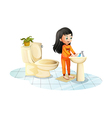 A cute little girl washing her hands vector