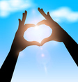 Love shape hand silhouette in sky concept vector