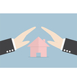 Businessman protect house by hands vector