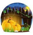 Burning pumpkins under the fence vector