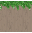 Wood background with christmas tree branches vector