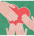 Hand holding the heart charityhands hold a heart vector