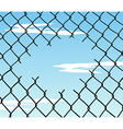 Cut wire fence with blue sky background vector