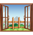 A window with a view of the backyard vector