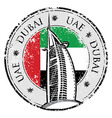 Grunge stamp with the flag and town dubai emirate vector