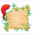 Bamboo frame with santa hat vector