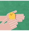 Young chicken in hand vector